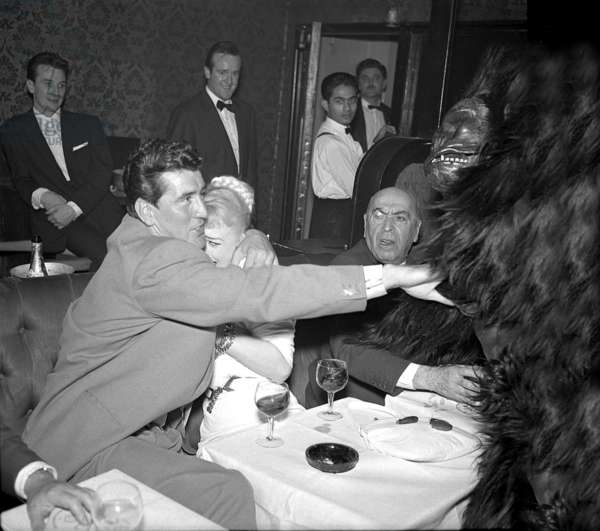Stuntman Tommy Yeardye and actress Sabrina, frightened by man in Gorilla suit, Stork Room, London, UK, 1958