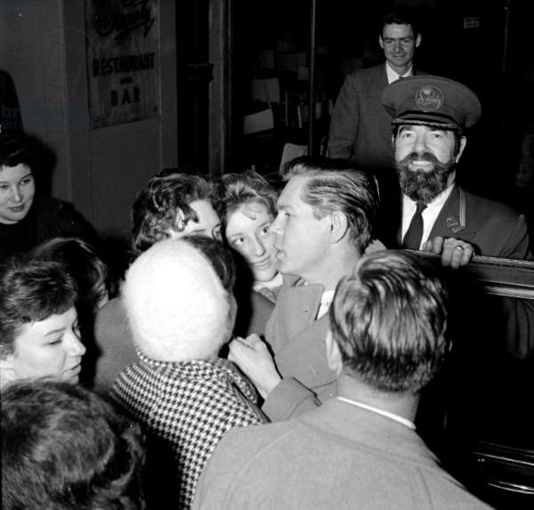 Johnny Ray with fans and doorman Tom, London, UK, 1954 (b/w photo)
