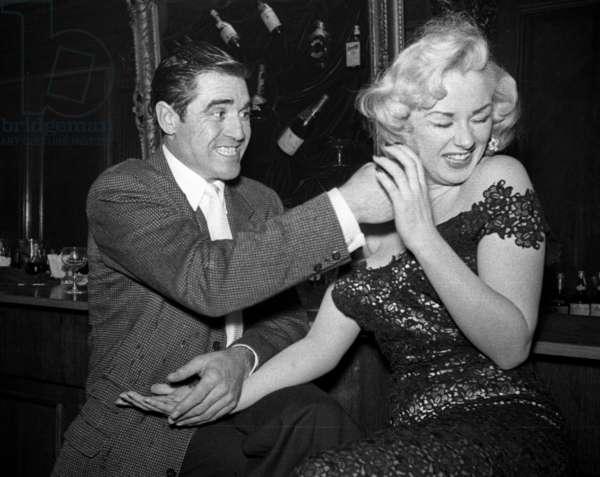 Steve Cochran tweaking Sabrina's ear, Society Bar, London, UK, 1956 (b/w photo)