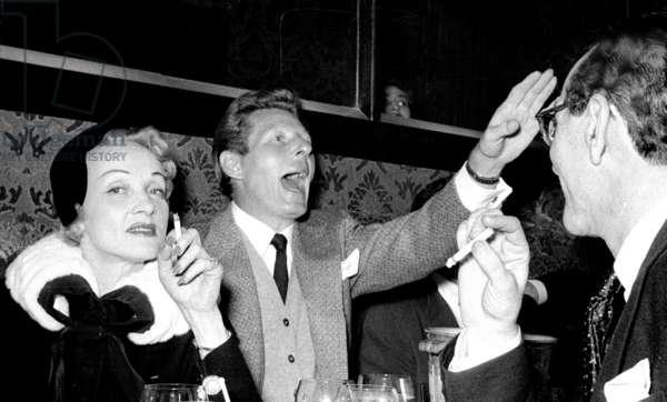 Marlene Dietrich with Danny Kaye and an unidentified friend, Stork Room, London, UK, 1956 (b/w photo)