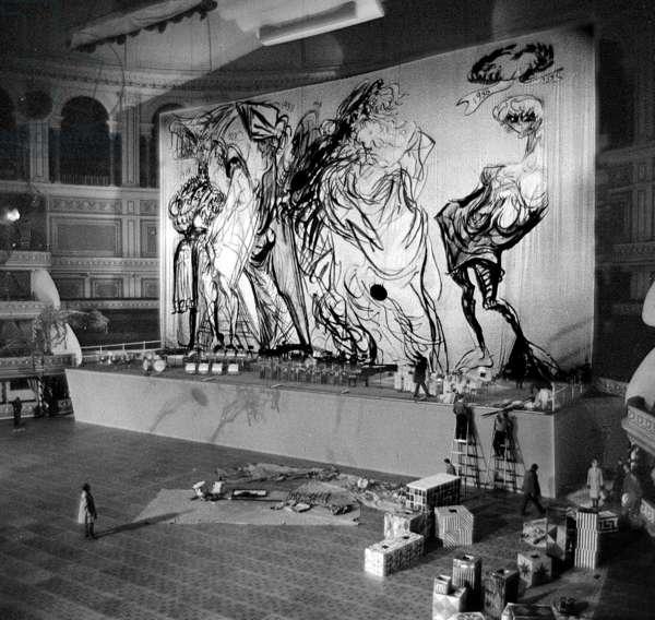 Feliks Topolski with his Chelsea Arts Ball backdrop, Albert Hall, London, UK, 1959 (b/w photo)