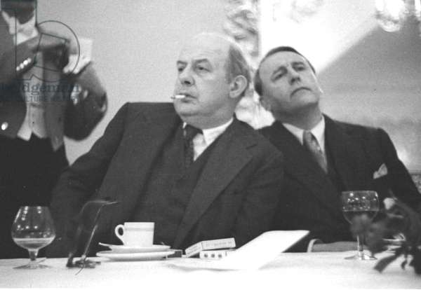 Poet John Betjeman and friend at Literary lunch, Quaglino's, London, UK, 1958 (b/w photo)