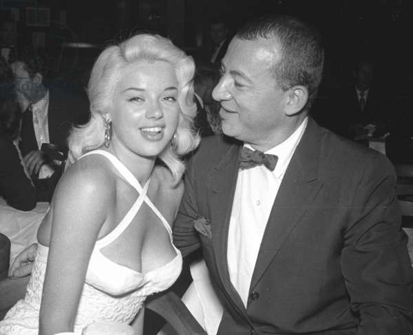 Diana Dors with unidentified American Stand-up comedian, London, UK, 1958 (b/w photo)