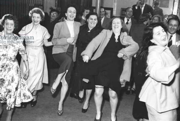 """Knees-up"" at a Wokingmans' Club, Peckham Rye, London, UK, 1953 (b/w photo)"