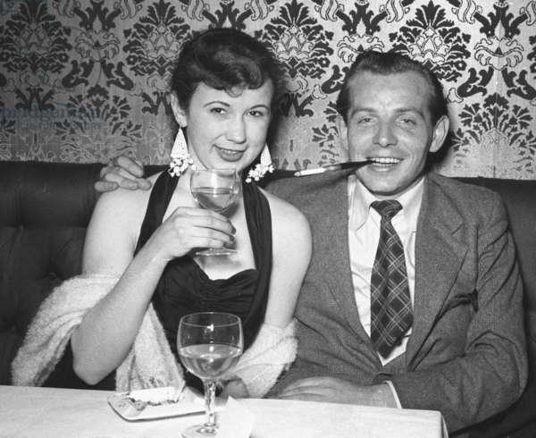 Showgirl and boyfriend, Stork Room, London, UK, 1955 (b/w photo)