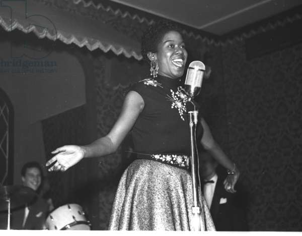 Sarah Vaughan singing at the Stork Room, London, UK, 1955 (b/w photo)