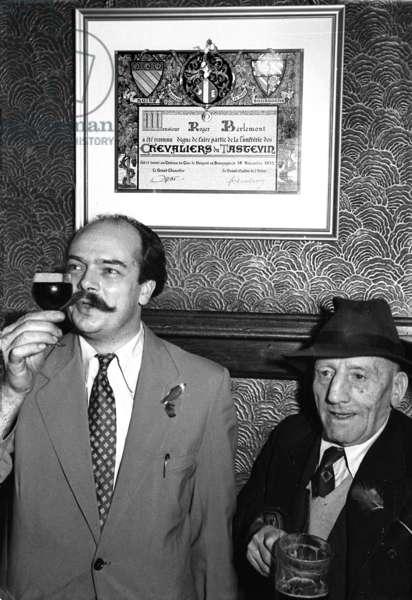 Gaston Berlemont and a customer, Bastille Day, the French House Pub, London, UK, 1953 (b/w photo)