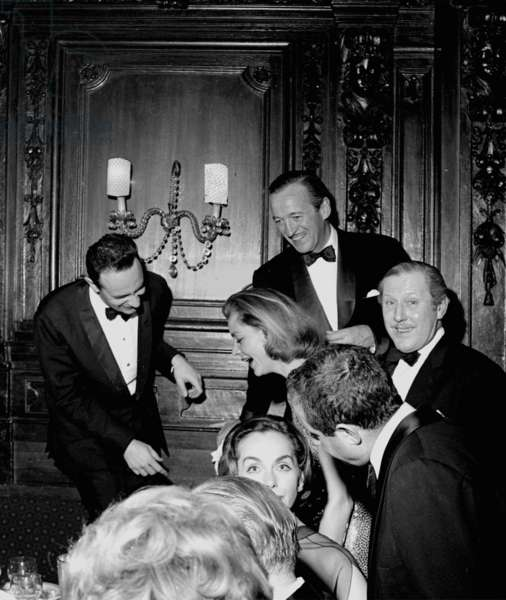 Stanley Donen, Lauren Bacall, David Niven, Reggie Coote and others, Society Restaurant, London, UK, 1956 (b/w photo)