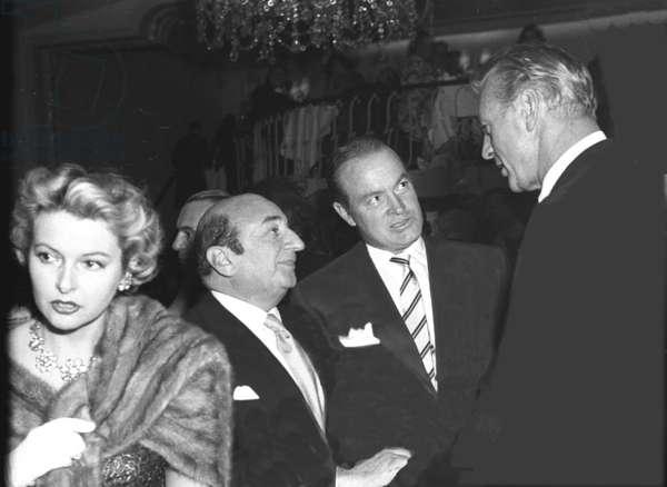 Gloria de Haven (possibly), a film producer, Bob Hope, Gary Cooper, Embassy Club, London, UK, 1955 (b/w photo)