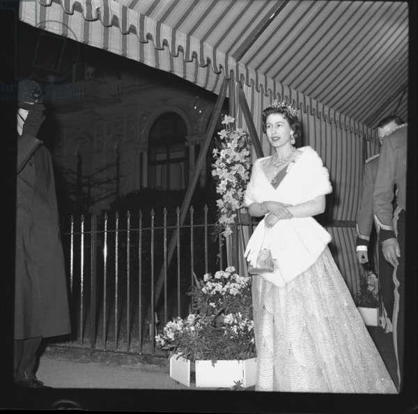 Queen Elizabeth II leaving Regimental Dinner at Hyde Park Hotel, London, 1958 (b/w photo)