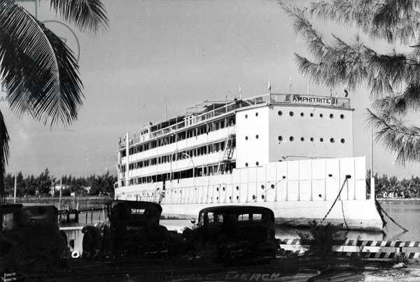 The USS Amphitrite as a floating hotel, anchored in the bay at Ft. Lauderdale Beach, c.1935 (b/w photo)