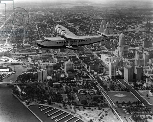 Pan Am's Brazilian Clipper flies over downtown Miami, c.1936 (b/w photo)