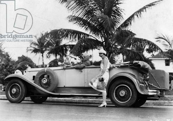 Mr. Albert Means at the steering wheel of his Packard Roadster, c.1931 (b/w photo)