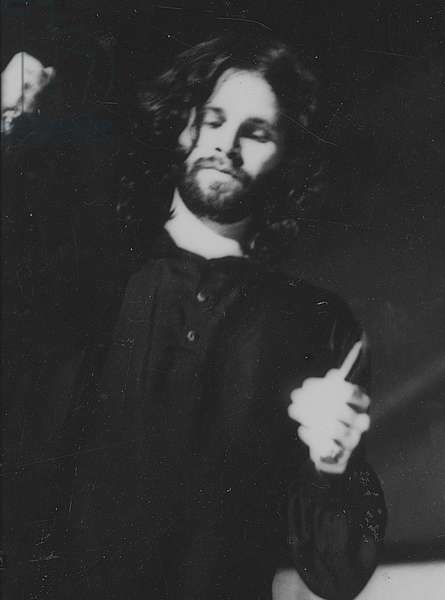 Jim Morrison in perfomance at the Dinner Key Auditorium, 1 March 1969 (b/w photo)