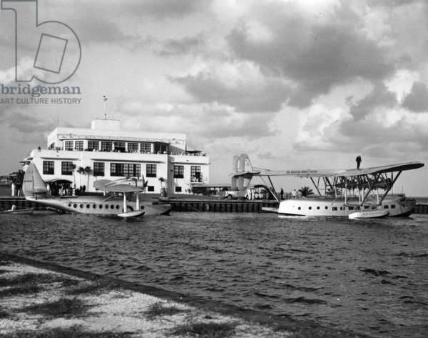 Two Sikorsky seaplanes docked behind the Pan American terminal building at Dinner Key, c.1936 (b/w photo)