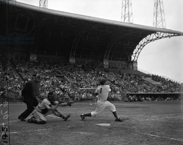 Pee Wee Reese bats for the Brooklyn Dodgers during a Dodgers-Braves game at Miami Stadium, March 1952 (b/w photo)