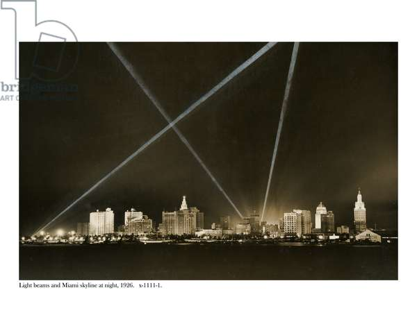 Light beams and the Miami skyline at night, 1926 (b/w photo)