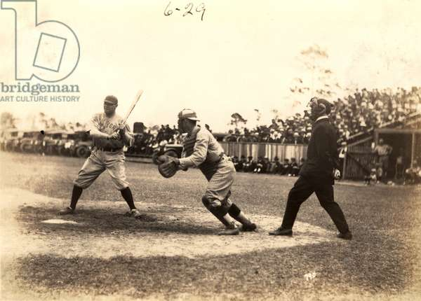 Babe Ruth plays ball during an exhibition game at Miami Field, March 16, 1920 (b/w photo)