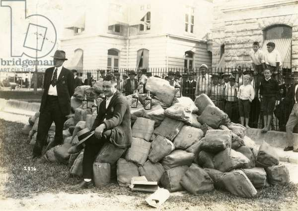 Sheriff Allen with Liquor outside Dade County Jail, Florida, 1922 (b/w photo)