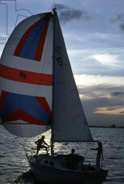 Sailing at dusk, c.1990 (photo)