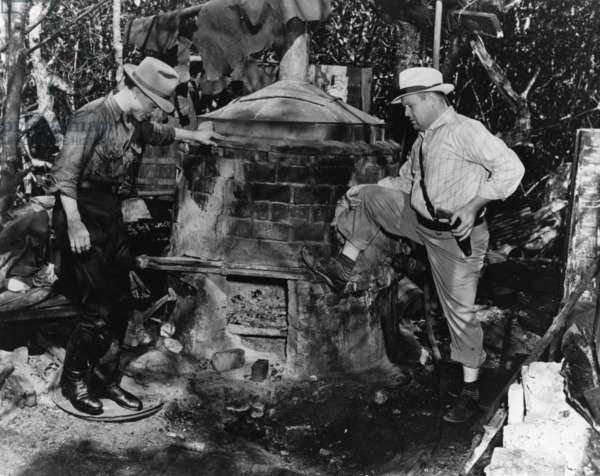 Illegal copper still in the Everglades, Florida, 1934 (b/w photo)