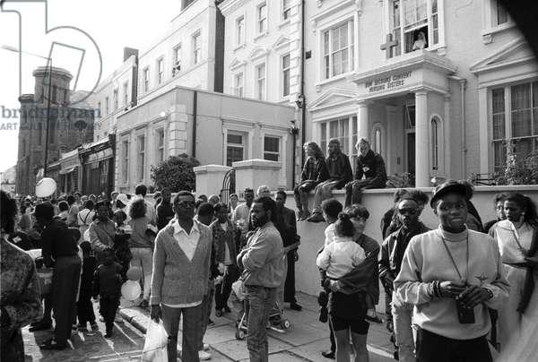 Notting Hill Carny Nun Watching, 1989 (b/w photo)