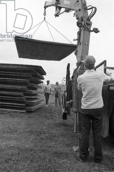 Glastonbury 89 Fence Build 1, 1989 (b/w photo)