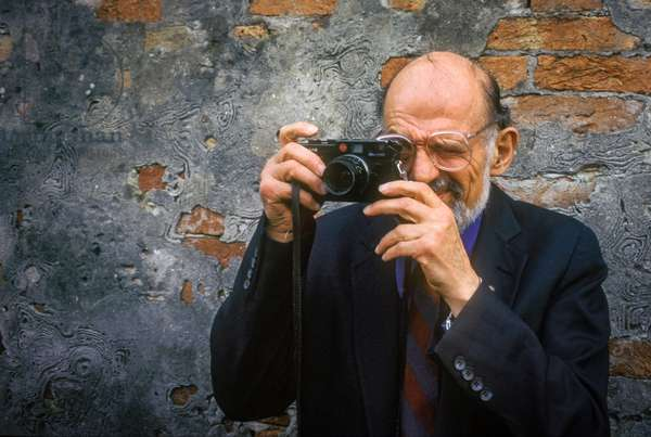 Venice, 1994. American poet Allen Ginsberg photographing (photo)
