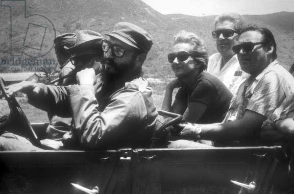 Italian journalist Rossana Rossanda in a car with Fidel Castro driving, Cuba 1967/La giornalista Rossana Rossanda in auto con Fidel Castro al Volante, Cuba 1967 - Reproduced by Marcello Mencarini