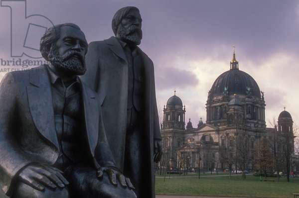East Berlin, 1989. The statues of Karl Marx (foreground) and Friedrich Engels in Marx-Engels-Forum. In the background is the dome of the Berliner Dom