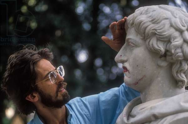 Rome, about 1990. Italian writer Luciano Allamprese and a bust of philosopher Giordano Bruno (photo)