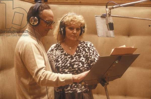 Rome, 1985. Italian soprano Katia Ricciarelli and the composer Ennio Morricone in a recording studio,/Roma, 1985. Il soprano Katia Ricciarelli e il composer Ennio Morricone in uno studio di registrazione -