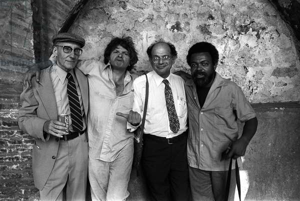 Portrait of Beat Generation poets William Burroughs, a can of coca cola in hand, Gregory Corso, Allen Ginsberg and Amiri Baraka (LeRoi Jones) in Rome in 1980.
