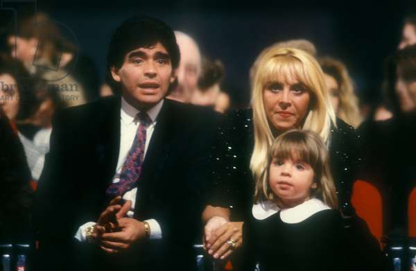 Argentine soccer player Diego Armando Maradona, his wife Claudia and one of their two daughter, 1991 (photo)