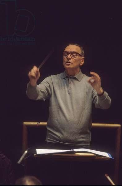 Rome, Pius XII Auditorium, 7-11-1998. Italian composer Ennio Morricone conducting a rehearsal/Roma, Auditorium Pio XII, 7-11-1998. Il compositore Ennio Morricone mentre directs una prova -