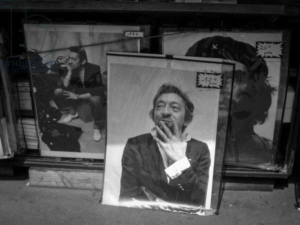 Posters of Serge Gainsbourg and Che Guevara exposed in a shop in Paris