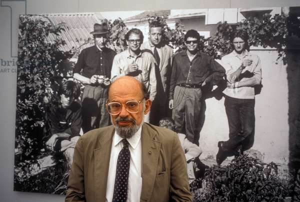 Venice, 1994. American poet Allen Ginsberg in front of a picture of some Beat Generation poets (he is the second from the left) (photo)
