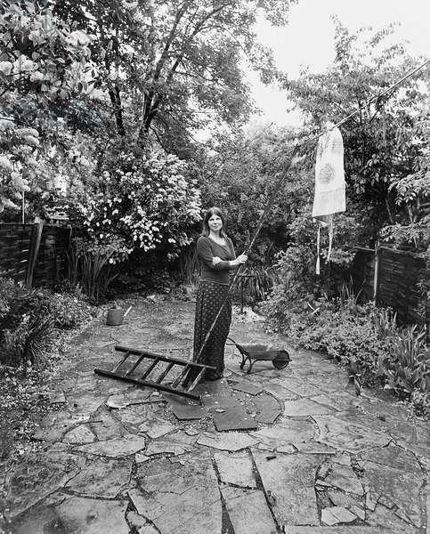 Margaret Drabble in garden, 1976 (b/w photo)