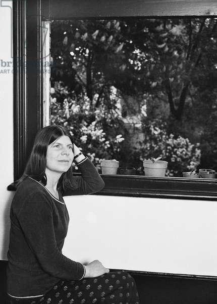 Margaret Drabble by window, 1976 (b/w photo)