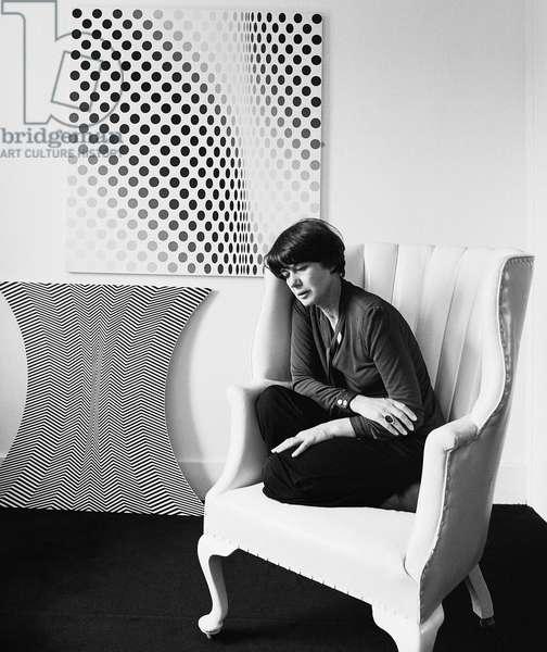 Bridget Riley in armchair, 1978 (b/w photo)