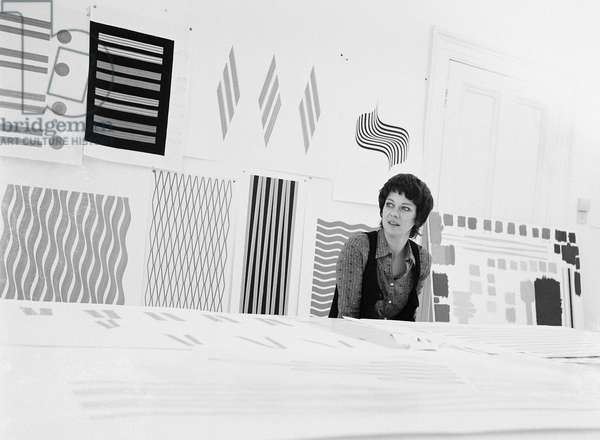 Bridget Riley at table, 1972 (b/w photo)