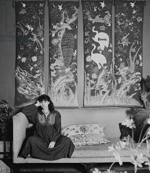 Marina Warner on sofa, 1977 (b/w photo)