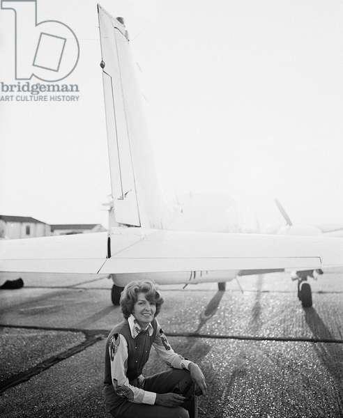 Sheila Scott with plane, 1977 (b/w photo)