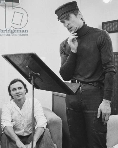 Rudolf Nureyev rehearsing a text, 1975 (b/w photo)