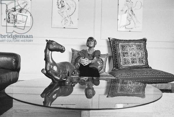 Elisabeth Frink with horse sculpture, 1973 (b/w photo)