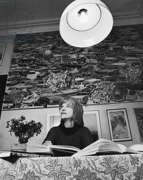 Alison Lurie with large lamp, 1978 (b/w photo)