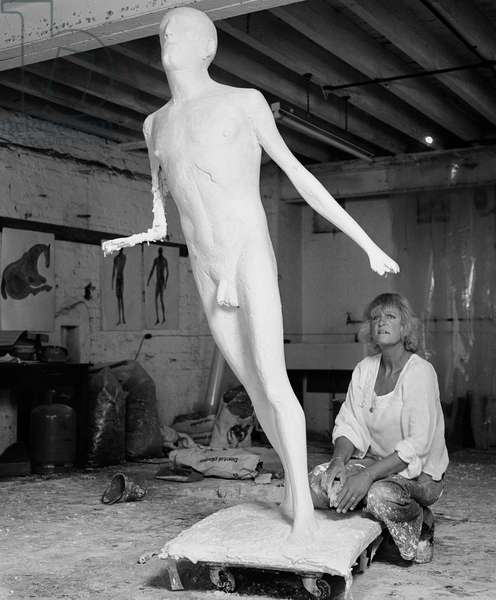 Elisabeth Frink with man in plaster, 1976 (b/w photo)