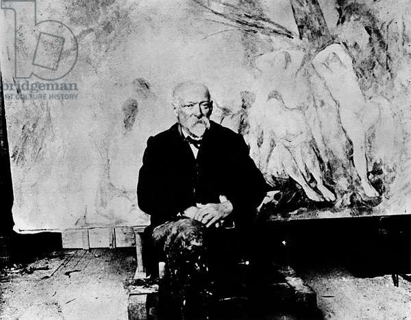 Portrait of Paul Cezanne (1839-1906) in front of his painting 'The Large Bathers', 1904 (b/w photo)