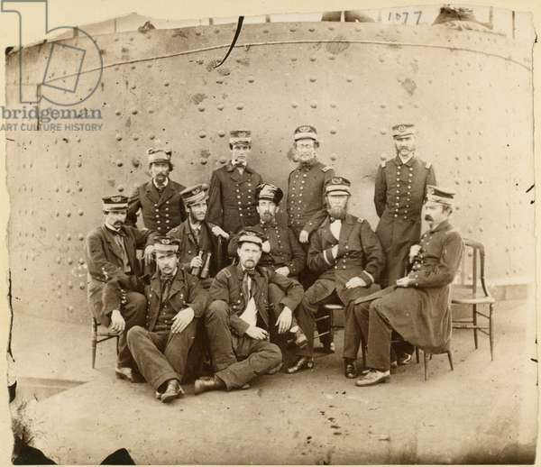 Officers of the USS Monitor posed in front of the turret, 1886 (b/w photo)