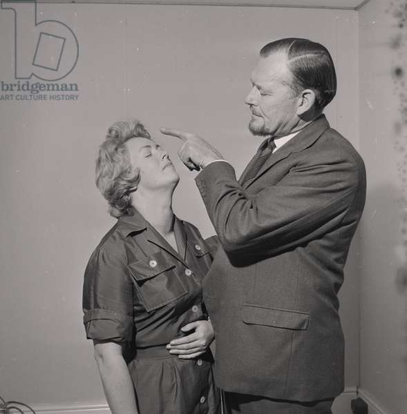 Hypnotist Josef Karma and Marjorie West, July 1965 (b/w photo)